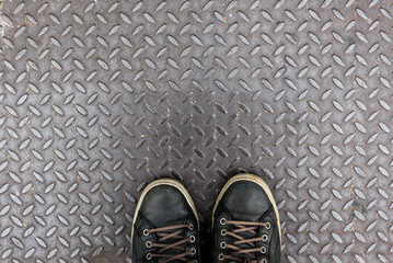 shoes on diamond iron plate texture as a background