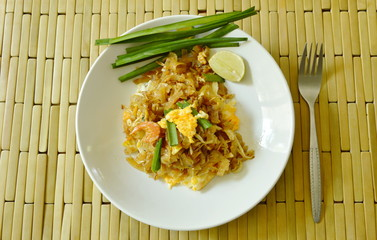 Pad Thai stir fried rice noodles with dry shrimp and egg on plate