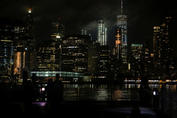 General view of the lower Manhattan night skyline as seen from the Brooklyn borough of New York City