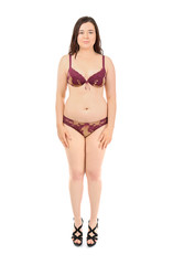Beautiful overweight woman in lingerie on white background