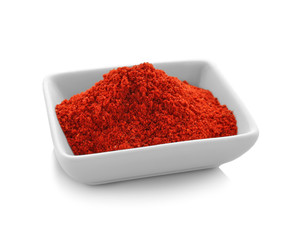 Bowl of goji powder, isolated on white