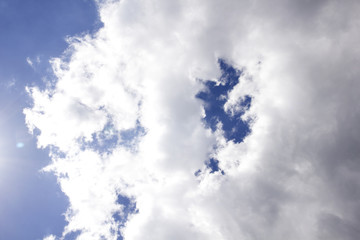 cumulus white clouds against a beautiful blue sky, bizarre patte