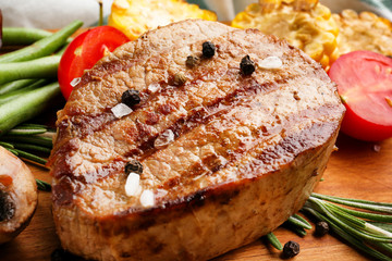 Wall Mural - Tasty grilled steak on table, closeup