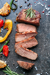 Wall Mural - Delicious sliced steak with vegetables on table