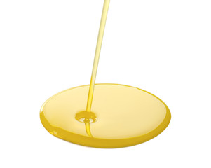 Spilling cooking oil on white background