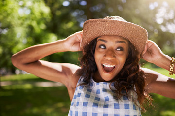 happy smiling african american girl looking left