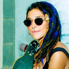 Pretty  Girl Skater with Dreadlocks. Street style