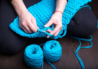 Close-up of woman hands knitting. Top view