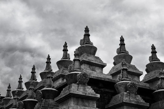 A black-and-white photo, the beautiful white tower of the Tibetan temple in Daocheng, Sichuan, China