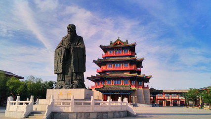 the giant  statue of Confucius and ancient chinese pavilion in the ancient capital  Kaifeng, China