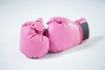 Close-up of pink boxing gloves