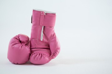 Close-up of pink boxing gloves pair