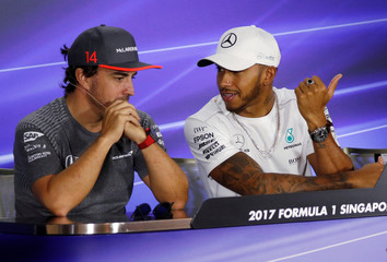 Mercedes F1 driver Hamilton and McLaren driver Alonso attend a publicity event ahead of the Singapore F1 Grand Prix night race in Singapore