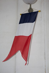 French flag displaying on a pole in front of the house