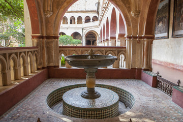 Mudejar cloister of Guadalupe Monastery. Baptismal font