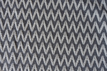 Textile with woven geometric zigzag pattern