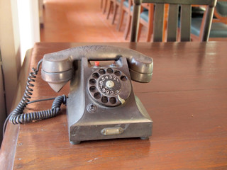 Retro black telephone on wooden table