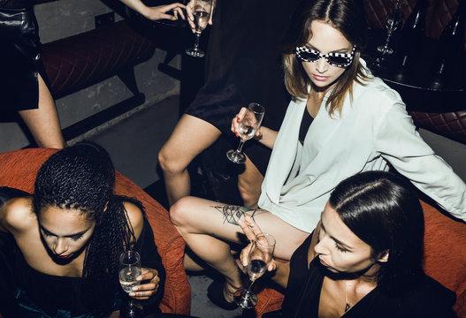 Stylish females in club