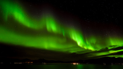 Aurora borealis or northern lights in the sky at Tromso, Norway