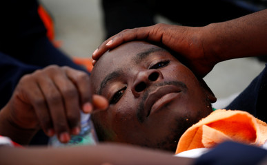 Migrant rests after being rescued by SOS Mediterranee organisation during SAR operation with the MV Aquarius rescue ship in the Mediterranean Sea