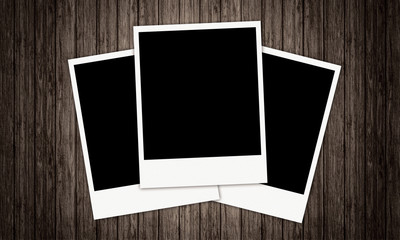 Three Old-fashioned vintage Photo Frames with a wood background