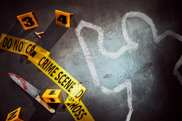 White outline with bloody knife at crime scene