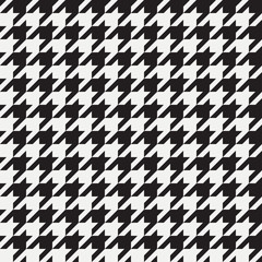 Houndstooth seamless pattern. Background for clothing and other textile products. Black and white backdrop. Vector illustration.