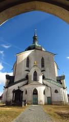 UNESCO Pilgrimage Church of St John of Nepomuk in Zdar nad Sazavou, Czech Republic through arch