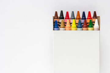 Colorful crayons in white box