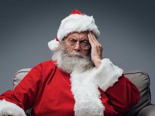 Santa Claus is having an headache