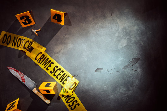 Bloody knife and cigarette stubs at a crime scene