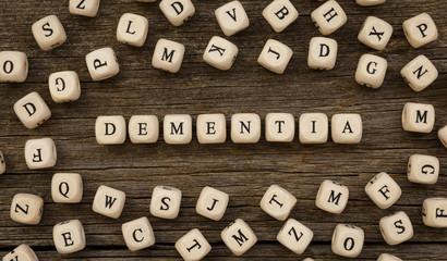 Word DEMENTIA written on wood block