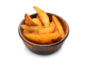 Bowl with delicious baked potato wedges on white background