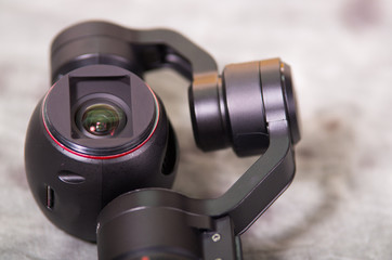 Close up of Osmo Mobile gimbal, new generation of electronic stabilizer over a gray background