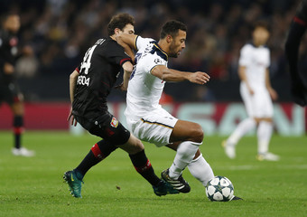 Bayer Leverkusen's Kevin Kampl in action with Tottenham's Mousa Dembele