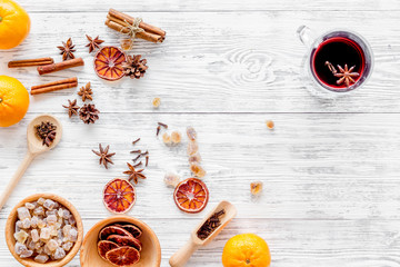 Ingredients mulled wine or grog with spices and citrus for winter evening. Christmas new year eve. Wooden background top view. Mock up