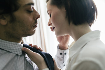 Close-up of man caressing woman's face