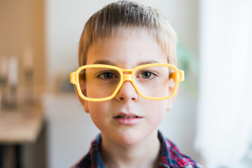little boy with yellow plastic glasses