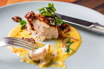 Eaten Grouper dish with yellow sauce