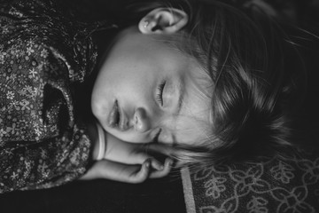 Cute little girl sleeping,  in black and white