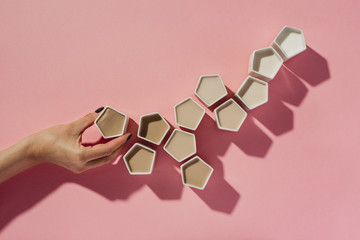 Woman making coffee ombre with geometric cups