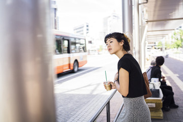 Japanese young woman at a bus stop in Japan
