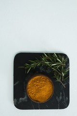 Rosemary with turmeric powder in bowl
