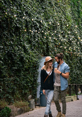 Couple walking together down a paved walkway