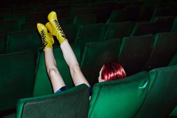 Fashion Model Sitting in the Cinema