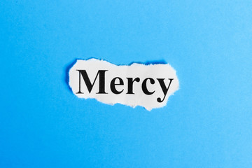 mercy text on paper. Word mercy on a piece of paper. Concept Image.