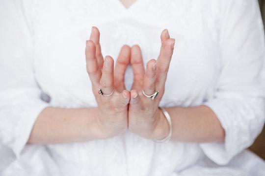Woman doing yoga mudra