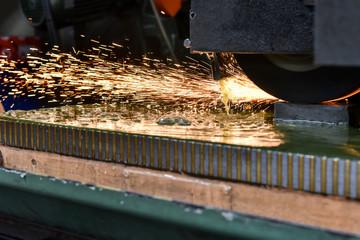 Grinding metal in a workshop