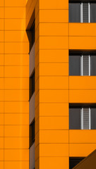 Detail of  facade on orange building.