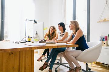Female team working together in a beautiful studio.